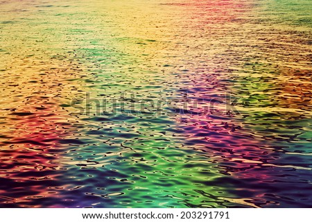 Colorful water ripples in the sea. Abstract hd background. Colours in the ocean  - stock photo