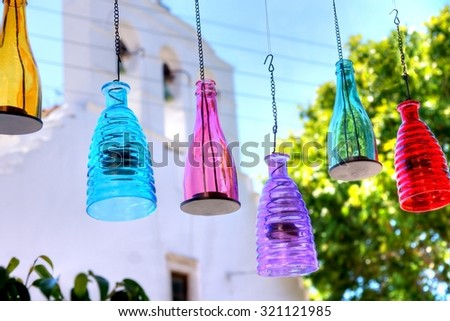 colorful waterbottles used as a lamp looks great  - stock photo