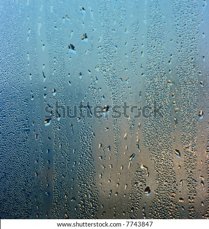 Colorful waterdrops on the window - stock photo