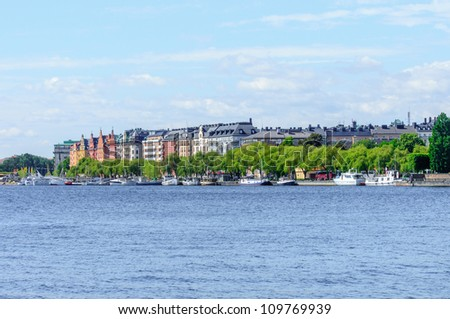 colorful waterfront buildings and docks in Stockholm, Sweden - stock photo