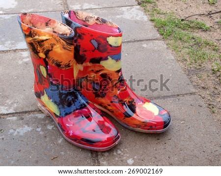 Colorful waterproof rubber or plastic boots outdoor horizontal       - stock photo