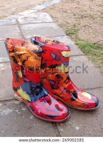 Colorful waterproof rubber or plastic boots outdoor vertical - stock photo