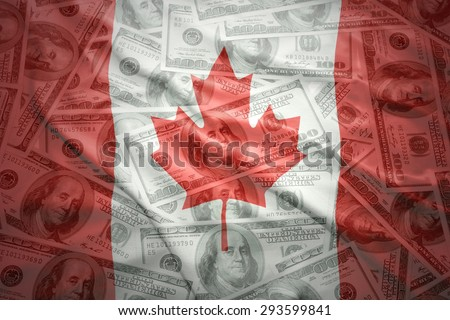 colorful waving canadian flag on a american dollar money background - stock photo