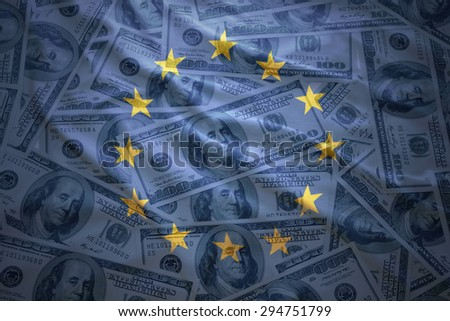 colorful waving european union flag on a american dollar money background - stock photo