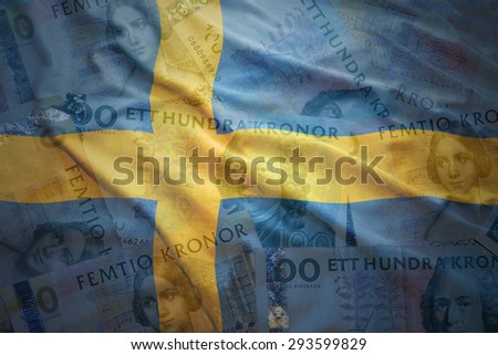 colorful waving swedish flag on a swedish crown money background - stock photo