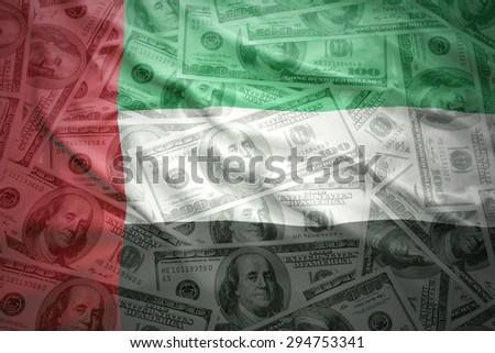 colorful waving united arab emirates flag on a american dollar money background - stock photo