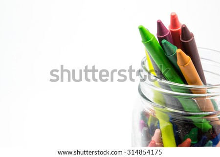 Colorful wax crayon pencils for school art  - stock photo