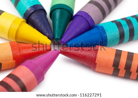 Colorful wax pencils isolated over white background