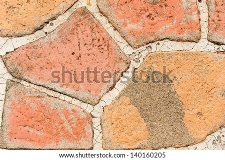 Colorful weathered stones pavement - background, texture - stock photo