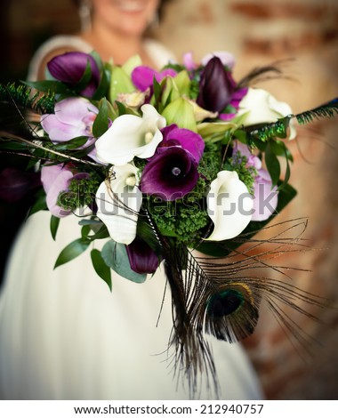 Colorful Wedding Bouquet With Peacock Feathers
