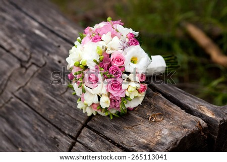 Colorful wedding bouquet with roses and freesia - stock photo