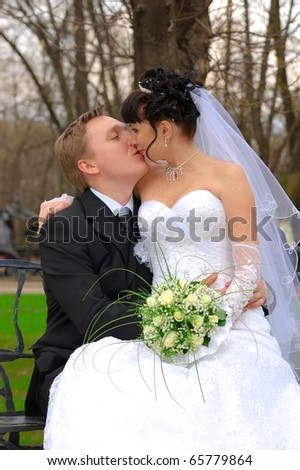 Colorful wedding shot of bride and groom kiss