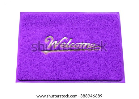 Colorful welcome doormat isolated on white background. - stock photo