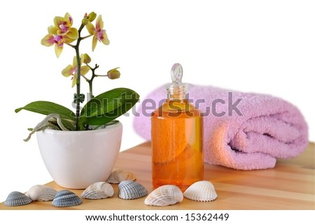 Colorful wellness set with massage oil, isolated on white - stock photo