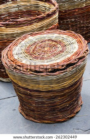 colorful wicker baskets typically handmade - stock photo