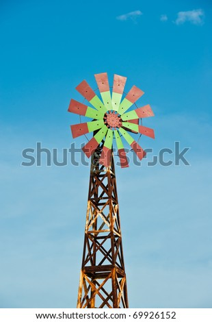 Colorful Wind Turbine with Blue Sky - stock photo