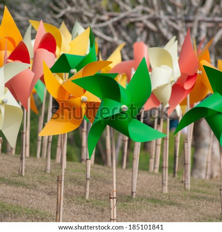 colorful windmill in folwer gaden. - stock photo
