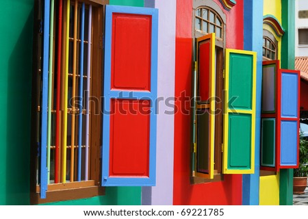 Colorful windows and detail on a colonial house in Singapore.  The picture is full of color. - stock photo