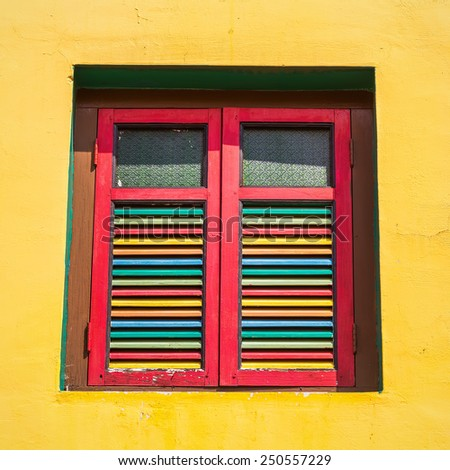 Colorful windows and details on a colonial house in Little India, Singapore - stock photo