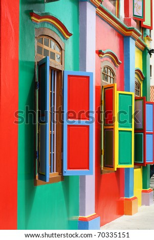 Colorful windows and details on a colonial house in Little India, Singapore.  Full of color, this picture has green, red, blue, yellow and pink. - stock photo