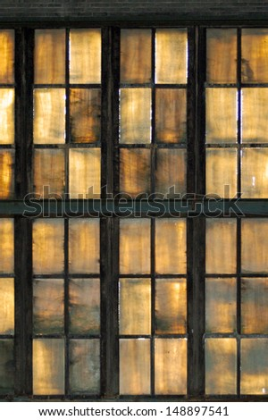 Colorful windows of an abandoned factory - stock photo