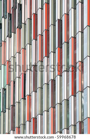 Colorful windows wall of the office building - stock photo