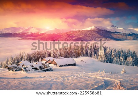 Colorful winter sunrise in the foggy mountains - stock photo