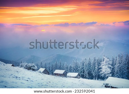 Colorful winter sunrise in the  foggy mountains. - stock photo