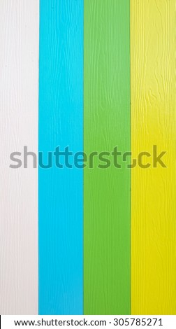 Colorful wood board at the fence texture background
