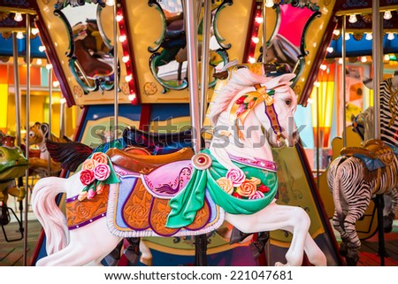 Colorful wood carousel horse at a carnival - stock photo