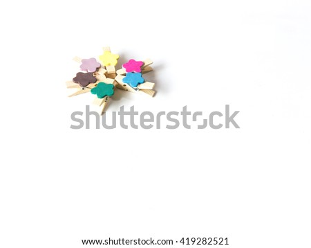 colorful wood paper clips isolated on white background - stock photo