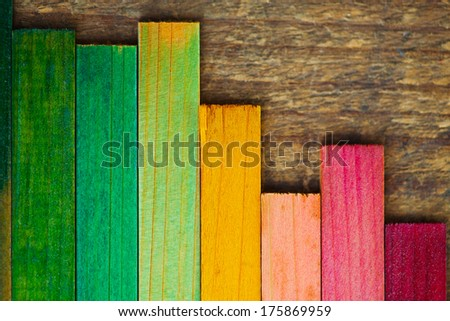 Colorful wood stain color test samples on rough wood. arranged like a bar graph.  - stock photo
