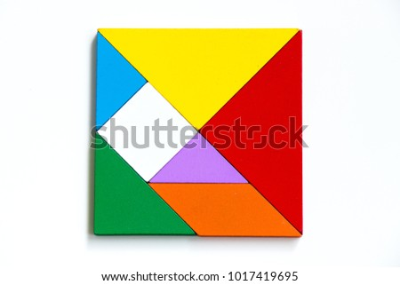 Colorful wood tangram puzzle in square shape on white background