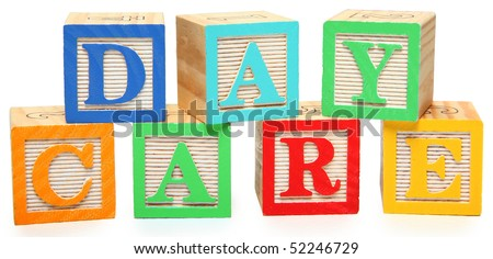 Colorful wooden alphabet blocks spelling the word day care. - stock photo
