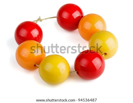 Colorful wooden beads bracelet isolated on white - stock photo