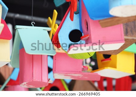 colorful wooden bird house - stock photo