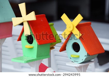 colorful wooden bird house as background - stock photo