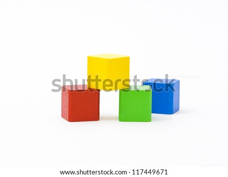 Colorful wooden building toy blocks isolated on white background - stock photo