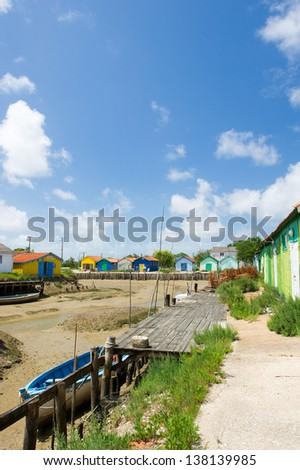 Colorful wooden cabins for oyster fishermen at Chateau de Oleron