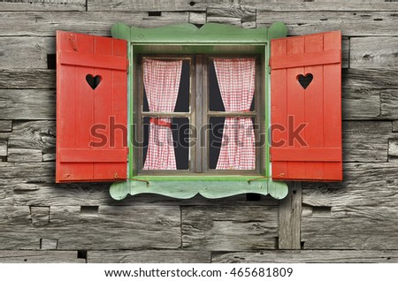Colorful Wooden Chalet Window on Weathered Wooden Wall