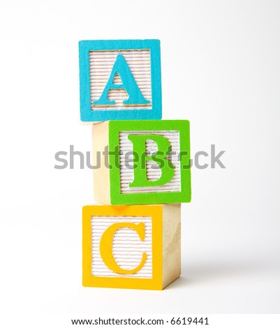 Colorful wooden children's alphabet blocks stacked upright - stock photo