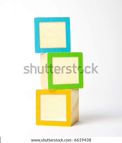 Colorful wooden children's blocks ready for your letters, symbols, or logos - stock photo