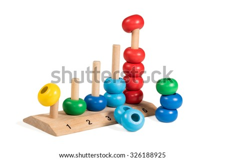 Colorful wooden children toy scores from one to five of the colored rings demounted isolated on a white background