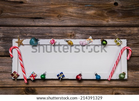 Colorful wooden christmas card, frame or background with decoration. - stock photo