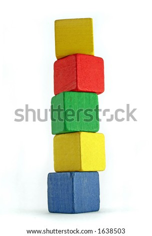 colorful wooden cilds blocks stacked into a very high tower - stock photo