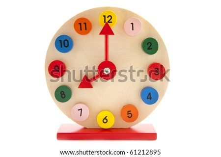Colorful wooden clock isolated on a white background - stock photo