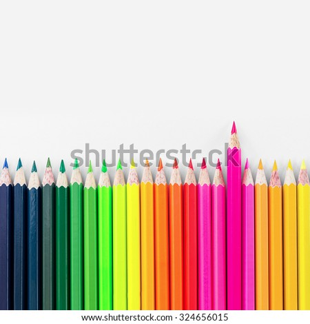 Colorful wooden crayon on white background. - stock photo