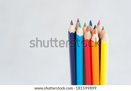 Colorful wooden crayons  edgewise, on white background, tips of pencils macro with extremely shallow dof. - stock photo