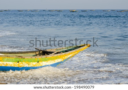 colorful wooden fishing boat on sea, India - stock photo
