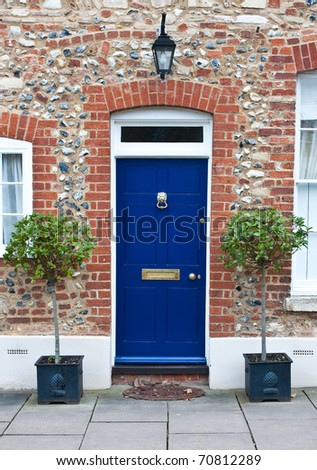 Colorful wooden front door - stock photo